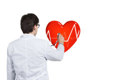 Doctor listens pulse Stock Image