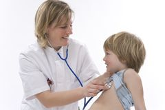 Doctor listens with stethoscope Royalty Free Stock Photo