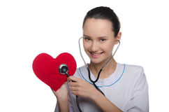 Doctor listens to heart stethoscope Royalty Free Stock Photo