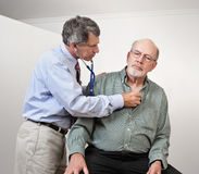 Doctor Listens to Older Man's Heart Royalty Free Stock Photography