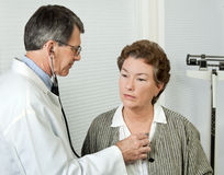 Doctor Listens to Patient's Heart stock photos
