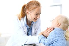 Doctor and a little blonde girl. Usual health exam. Medicine and healthcare concept.  stock photo