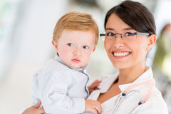 Doctor with a little boy Royalty Free Stock Photo