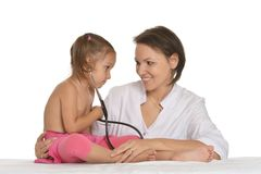Doctor with little girl Stock Images