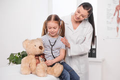 Doctor and little girl. Stock Image