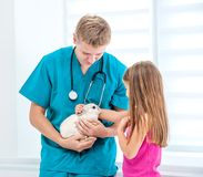 Doctor and little girl with a rabbit Stock Images