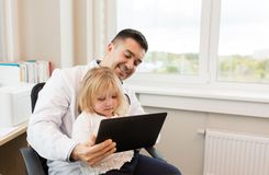 Doctor and little girl with tablet pc at clinic Stock Image