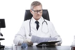 Doctor look and analyse blood test clipboard Stock Photo