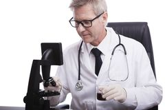 Doctor look and analyse blood test tube Royalty Free Stock Image