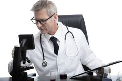 Doctor look and analyse blood test tube Stock Photo