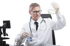 Doctor look and analyse liquid test tube Stock Image