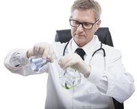 Doctor look and analyse liquid test tube Royalty Free Stock Photography