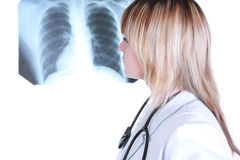 Doctor look x-ray picture. Young girl is looking to x-ray picture Royalty Free Stock Images