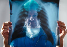 Doctor looking. At an x-ray Stock Image