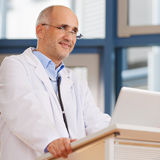 Doctor Looking Away At Podium Royalty Free Stock Photography