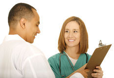 Doctor Looking At ClipBoard Royalty Free Stock Photography