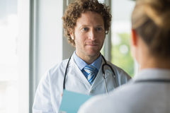 Doctor looking at colleague Royalty Free Stock Photography