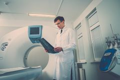 Doctor looking at the computed tomography result Stock Photos