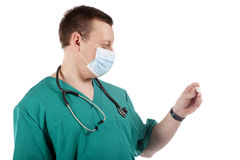 Doctor looking at a digital thermometer. Stock Photography