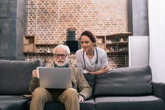 Doctor looking at laptop in senior. Patient hands stock images