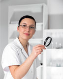 Doctor Looking Through Magnifying Glass Stock Photos