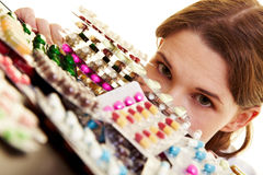 Doctor looking at many pills Royalty Free Stock Photography