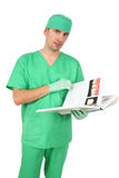 Doctor looking at medical book Royalty Free Stock Photo