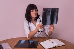 Doctor looking at patient`s x-ray of a foot royalty free stock photography