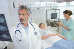 Doctor looking at radio result Royalty Free Stock Photo