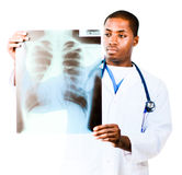 Doctor looking at an x-ray. Young Doctor looking at an x-ray royalty free stock photography