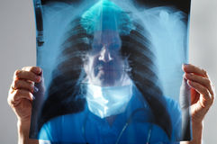 Doctor looking at an x-ray. Focus on x-ray Royalty Free Stock Image