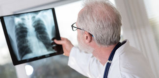 Doctor looking at x-ray. Report royalty free stock photos