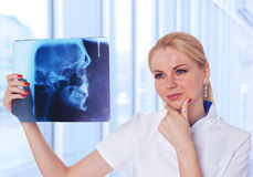 Doctor looking at X-ray results of  her patient Stock Image