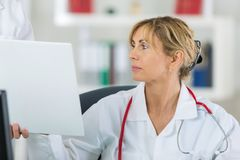 Doctor looking for resemblance results. Doctor looking for the resemblance of the results Stock Images