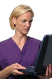 Doctor looking to a lap top co Stock Photo