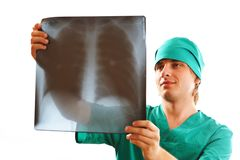 Doctor looking at x-ray Stock Photos
