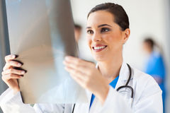 Doctor looking at x-ray Royalty Free Stock Photography