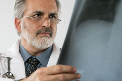 Doctor Looking at X-ray. Isolated Stock Photo