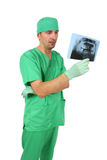 Doctor looking at x-ray (isolated on white) Stock Image