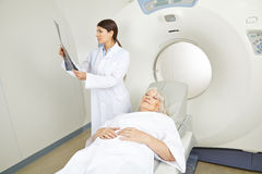 Doctor looking at x-ray at MRI therapy Royalty Free Stock Photography