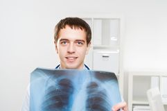 Doctor looking the x-ray Stock Image