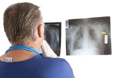 Doctor looking at x-rays Stock Photo