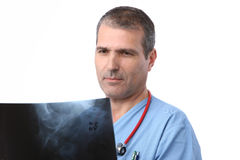 Doctor looking at a xray. In a white background royalty free stock photo