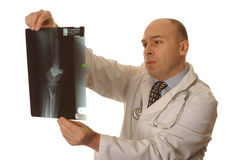 A Doctor looking at an xray Stock Photography