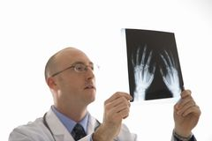 Doctor looking at xrays. Stock Photos
