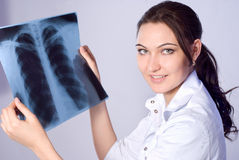 The doctor looks lung X-ray Royalty Free Stock Photo