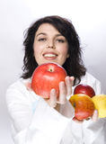 Doctor with lot of apples Stock Photos