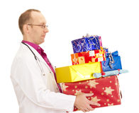 Doctor with a lot of gifts Royalty Free Stock Photography