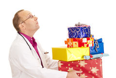 Doctor with a lot of gifts Royalty Free Stock Images