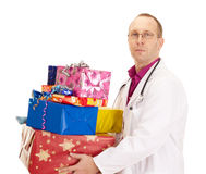 Doctor with a lot of gifts Stock Photos